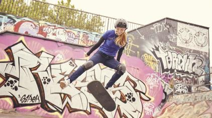 Girl doing a flip on a skateboard
